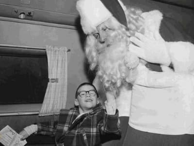Old-time photo of Santa and child