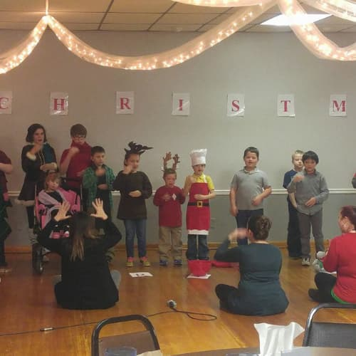 Kids using sign language at Christmas Party