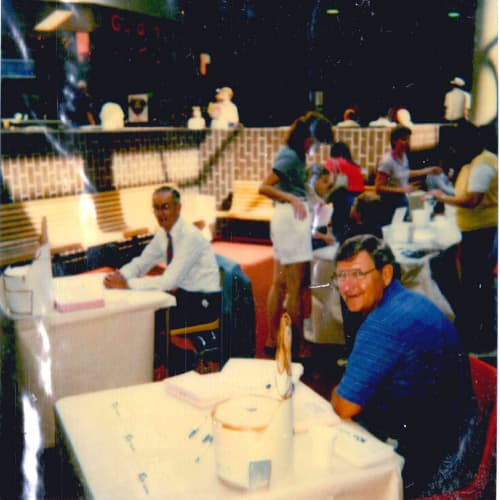 Old-time photo of men at Quincy Mall