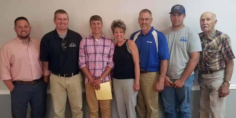 Teenager Accepting Award with family